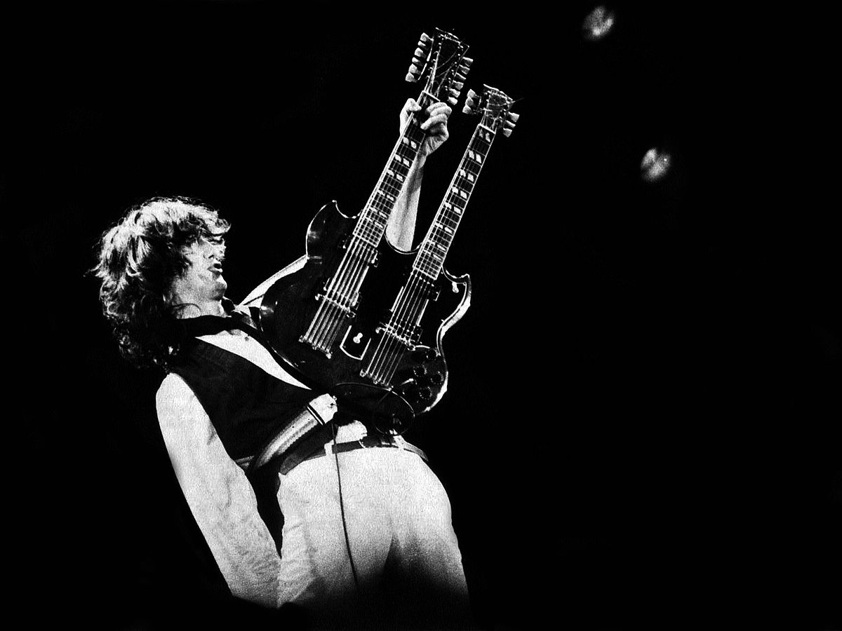 1200px-Jimmy_Page_-_A.R.M.S._Concert,_Oakland,_Ca._1983